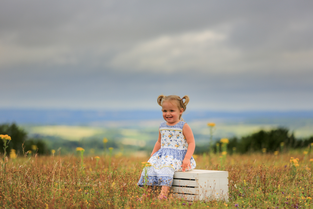 during a family photography shoot in Winchester, photographer captures young girl on Stockbridge Down