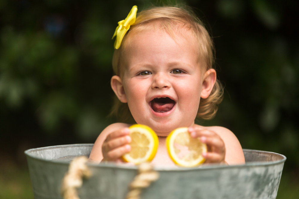 baby plays with lemons during her baby fruit shoot