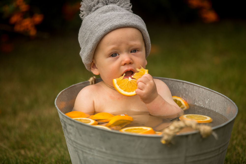 eating oranges during a baby fruit shoot
