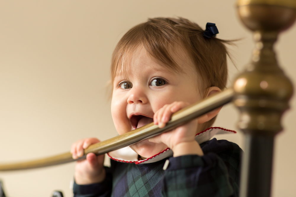 baby photographer in chandlers ford - baby chewing bed post and giggling