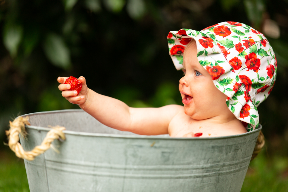 eating a strawberry during a baby fruit shoot