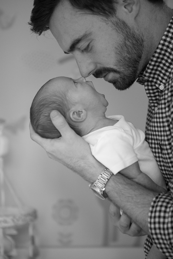 dad and baby gazing at one another during a baby photoshoot in chandlers ford