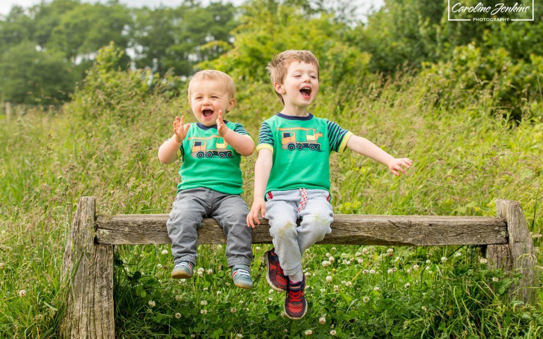 Kids photographer in Winchester captures two brothers singing their hearts out on a bench in Testwood Lakes