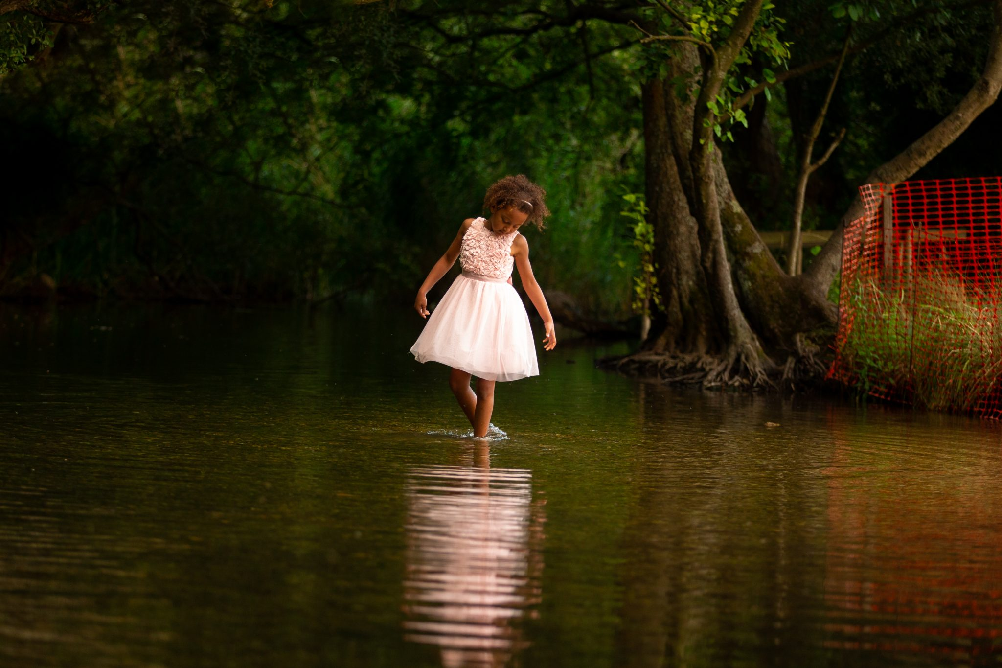 family photographer in chandlers ford - young girl doing ballet in the water