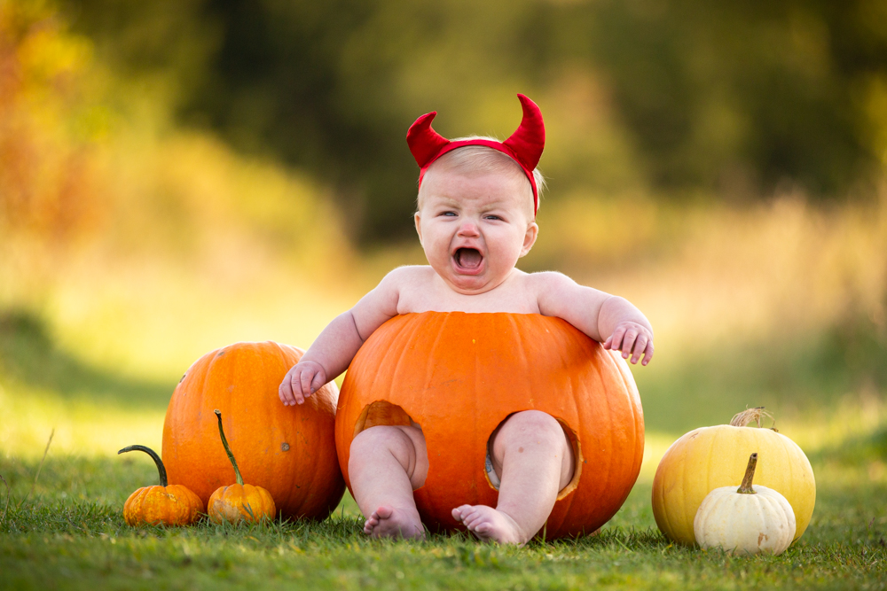 baby dressed up as little devil during a baby pumpkin shoot