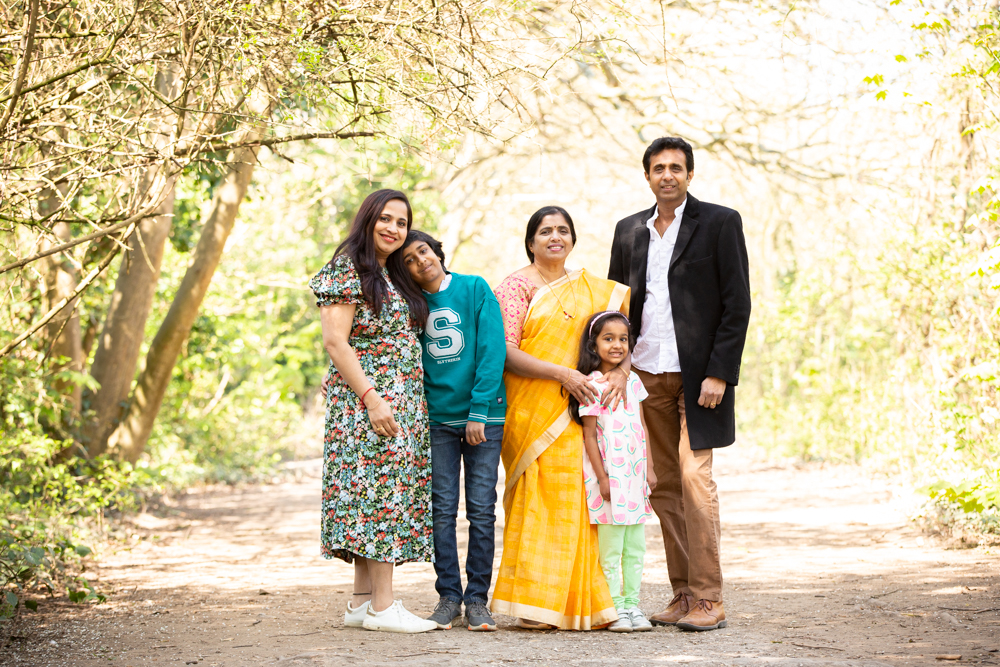 during a family photoshoot at Lakeside a family of five is captured among the blossom