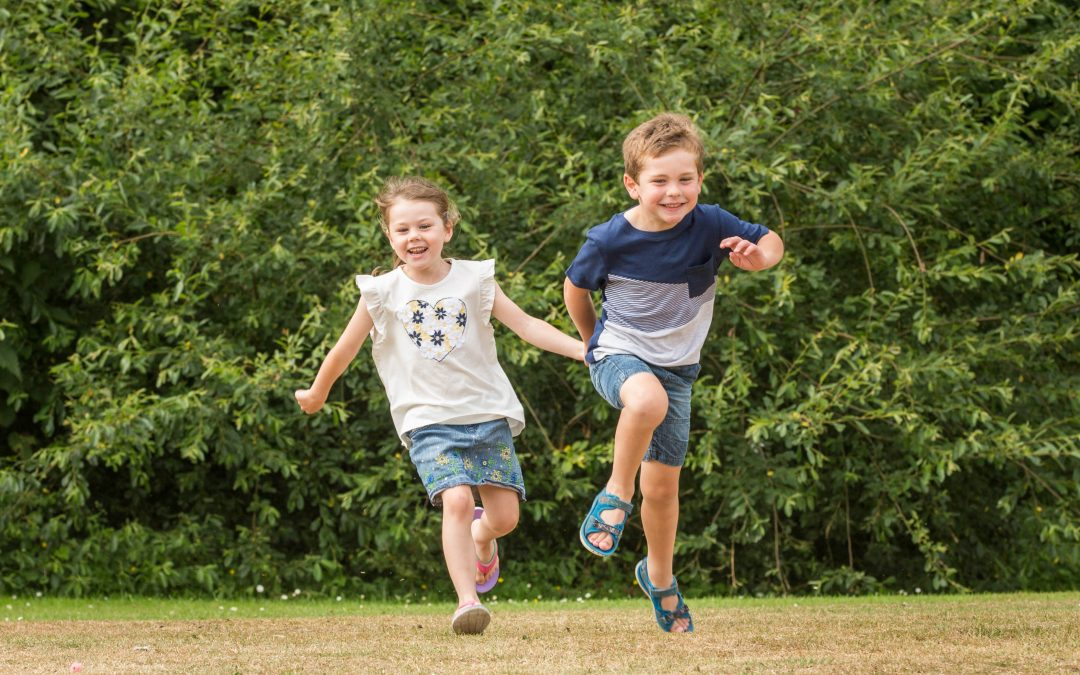 Photography shoot in Chandlers Ford - friends running and laughing together