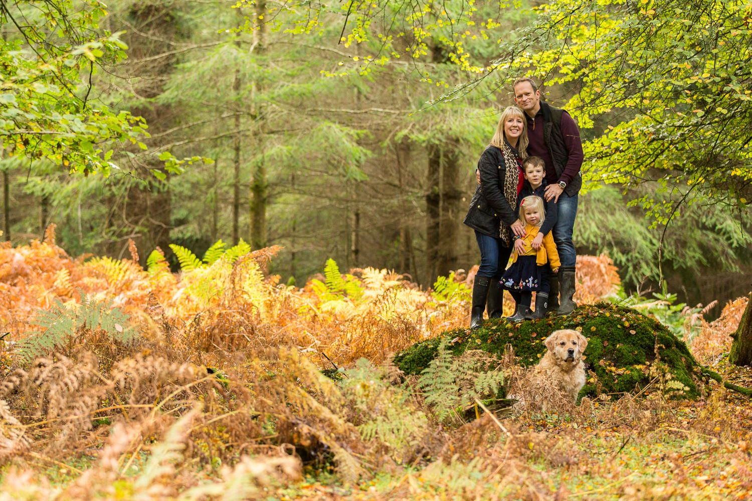 family and dog cuddle up during a family photoshoot in Chandlers Ford