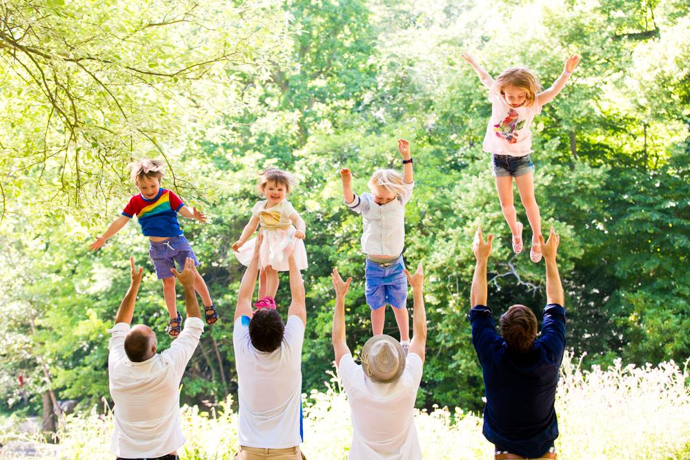 active kids - children being thrown in the air