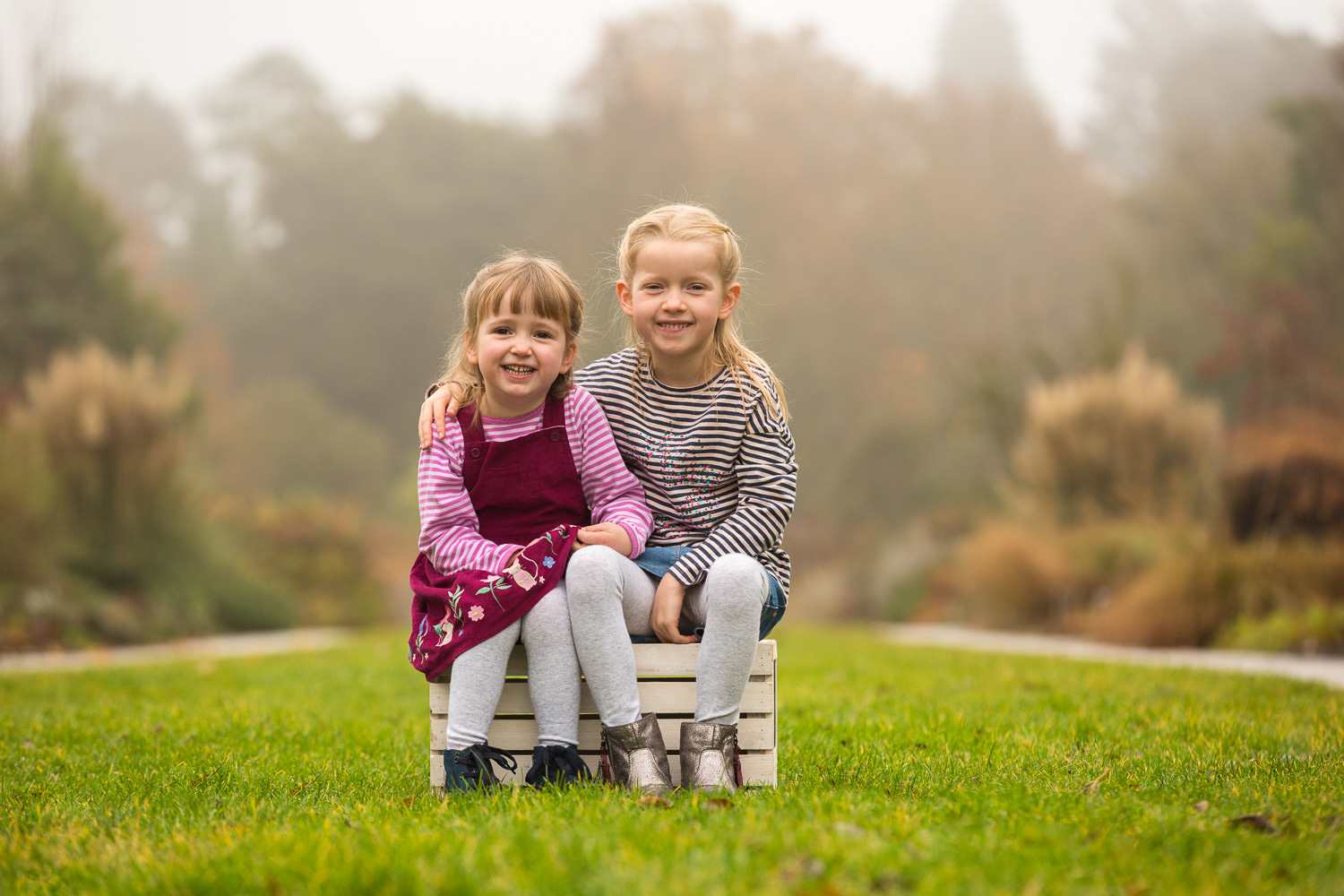 girls sit along Centenary Border in Hilliers photoshoot
